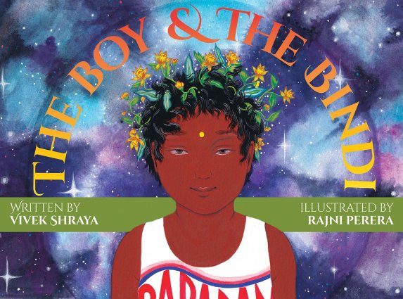 Picture book cover showing a boy with brown skin and dark hair wearing flowers in his hair and a bindi on his forehead.