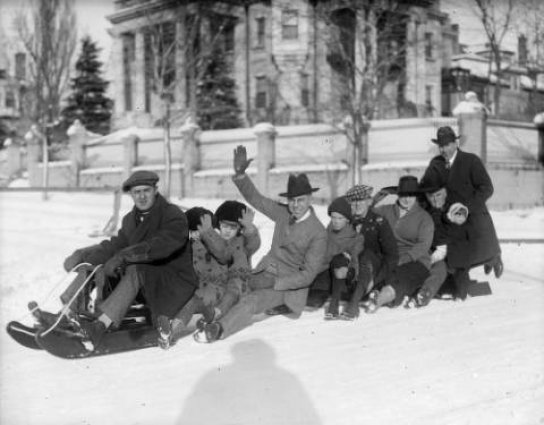 Group sledding in Denver by Harry Rhodes (taken between 1920 and 1940)