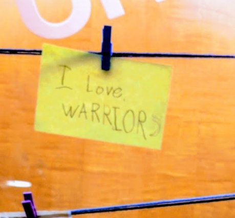"""Image of a slip of paper reads, """"I love Warriors!"""""""