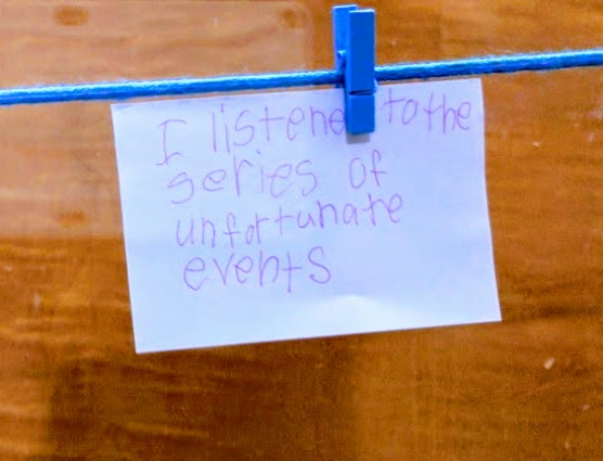 """Image of a slip of paper reads """"I listened to A Series of Unfortunate Events"""""""