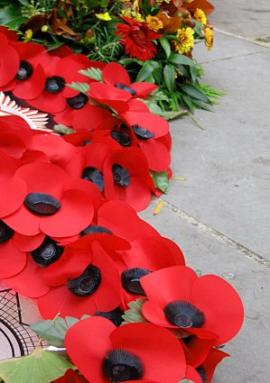 Wreaths constructed with artificial poppies used as a symbol of remembrance.