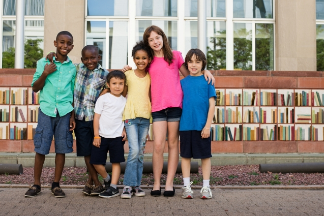 A group of children standing outside the Central Library