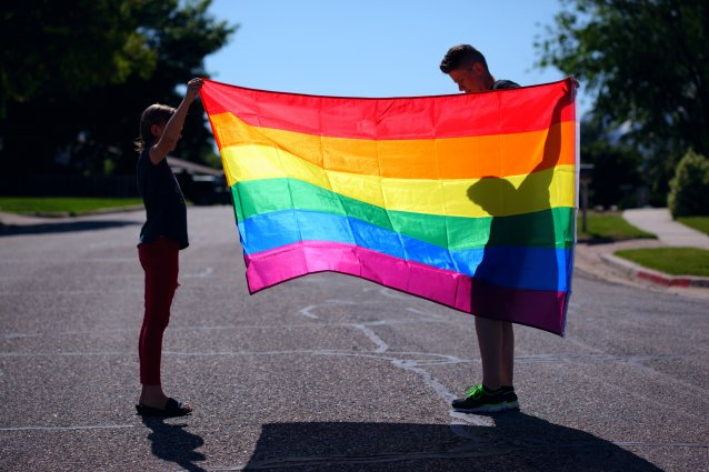 man and child with rainbow flag