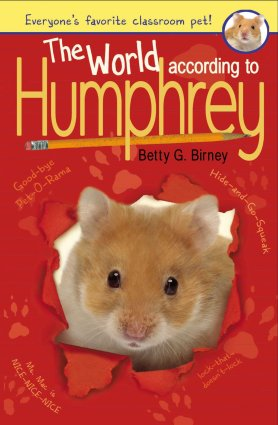 Image depicts red book cover of The World According to Humphrey with a furry hamster face peeking through the center