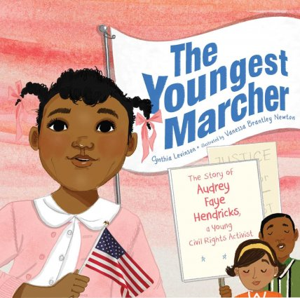 Image depicts The Youngest Marcher: the Story of Audrey Faye Hendricks book cover with a young Black girl holding a flag