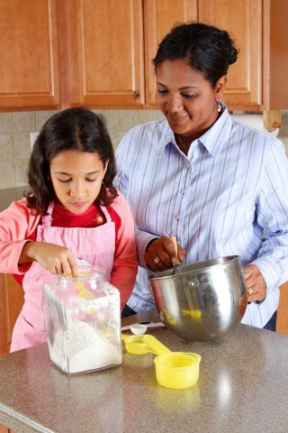 Woman and child cooking together