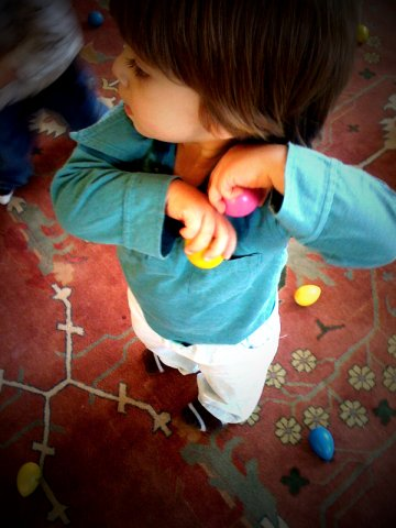Child playing with egg shakers