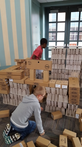 Children building with boxes
