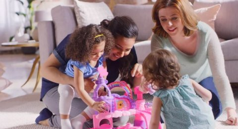 A family interacts and shares conversation while playing with a toy castle.