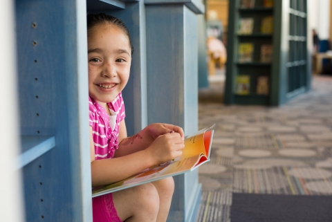 Girl smiling and reading