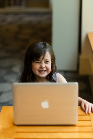 Child uses laptop computer