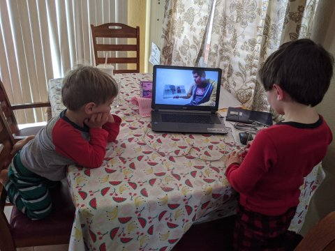 Two children watching virtual storytime