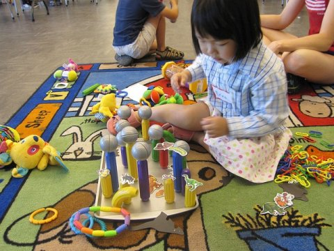 Girl playing with sensory toys
