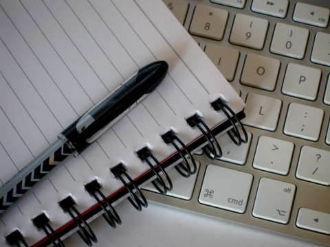 notebook, pen and keyboard