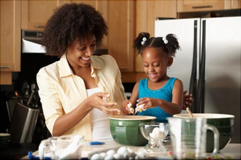Child cooking with her mom