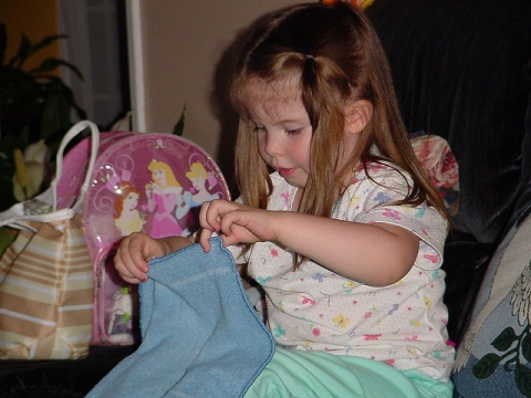 Young girl folding laundry